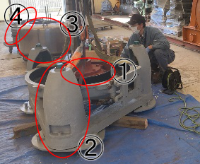 脱水機を分解し始めたところの写真です。写真に印を付け、各部の説明をしています。